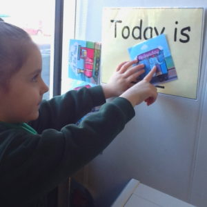 Nursery Child learning days of the week