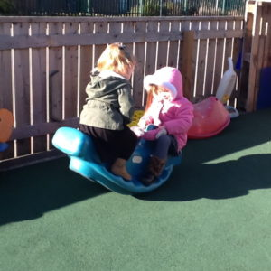 Nursery Children Playing on a see saw