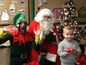 Nursery Child with Santa and his Elf