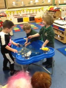 Nursery children playing with a water tray