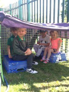 Nursery Children playing in a den